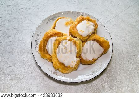 Puff Pastry Cookies With White Icing Sugar On A Round Plate. Confectionery Products Drinks Tea Coffe