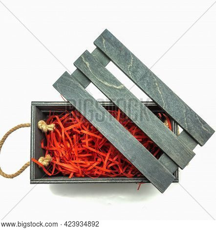 Wooden Box For Packing Gifts. Rope Handles, Black Board Cover. Bright Red Filler. Top View. Isolated