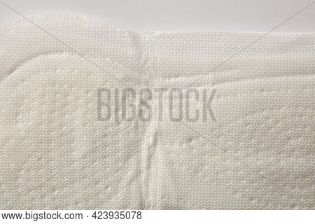 Soft Protective And Absorbent Cotton Wipe For Women's Care Macro On White Background. Top View. Hori