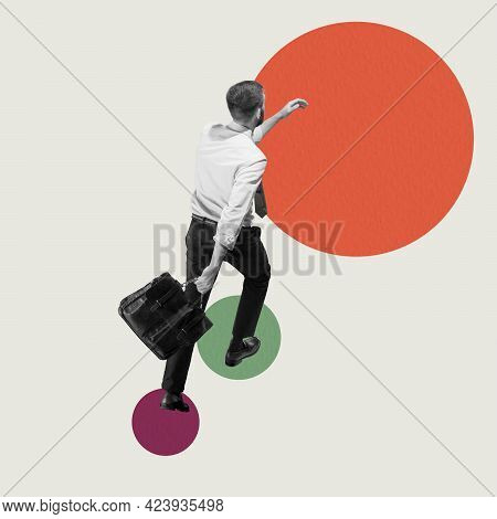 Career Ladder. Young Man, Businessman, Finance Analyst Or Clerk In Business Clothes Isolated On Purp