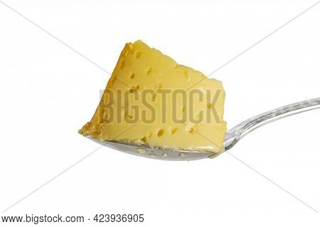 Cut piece of flan on spoon close up shot
