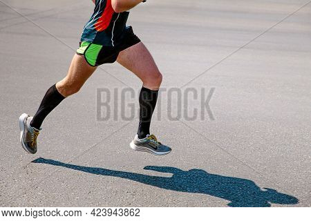 Chelyabinsk, Russia - May 30, 2021: Male Runner Athlete Running In Shoes In City Race