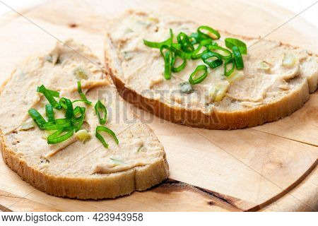 cracklings spread on bread with spring onion