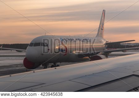 Yekaterinburg. Russia. 12/20/2020. The View From The Airplane Window Of The Runway And Part Of The S