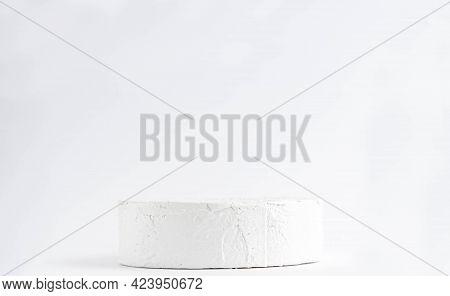 White Round Pedestal Podium. Abstract Cement Pedestal By Spotlights On White Background