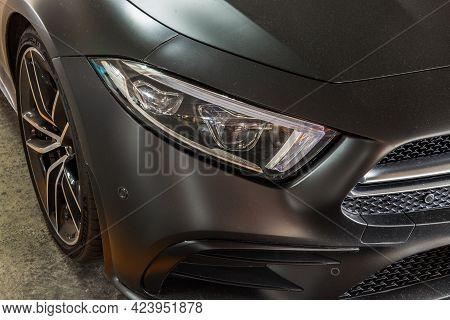 Bangkok, Thailand - 08 Jun 2021 : Close-up Of Headlights, Wheel, And Rim Of Matte Black Mercedes Spo
