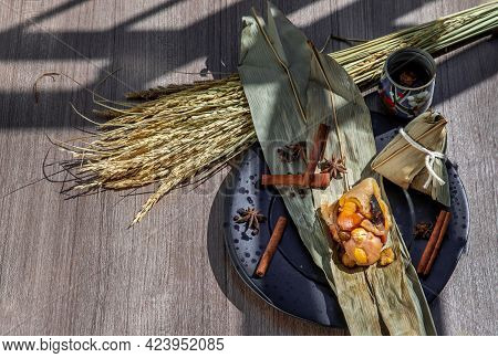 Chinese Rice Dumpling (zongzi) Shaped Pyramidal Wrapped By Leaves Ingredients On Dried Banana Leaf S