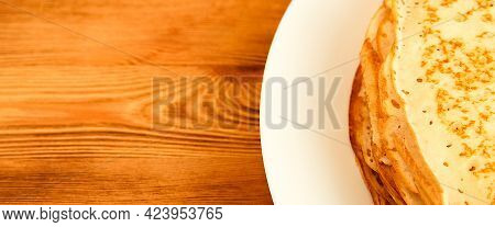 Pancakes On A Plate On A Wooden Table. A Large Stack Of Fresh Pancakes. Delicious Healthy Fresh Panc