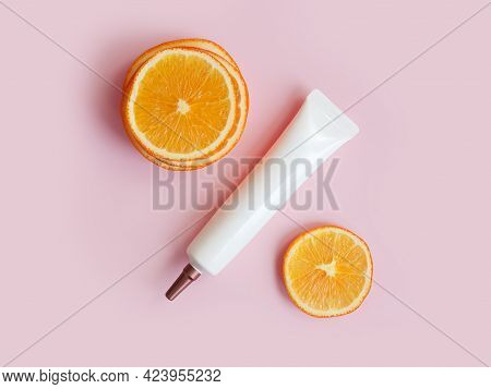 Unbranded Face And Eye Cream Squeeze Cosmetic Tube With Long Nozzle And Bronze Screw Cap And Orange