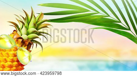 Pineapple With Sunglasses And Palm In The Beach. Summer Beach Concept.
