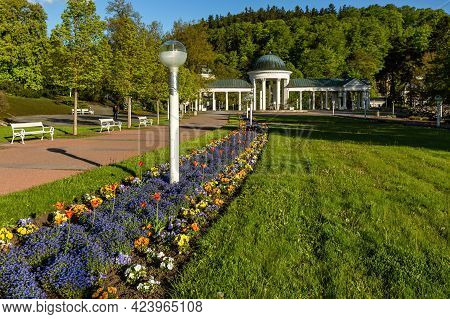 Marianske Lazne, Czech Republic - May 30 2021: View Of The White Pavilion Of Mineral Spring. Green L