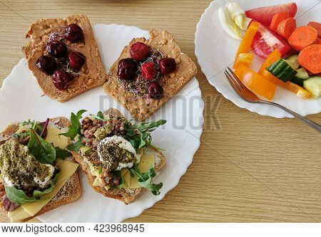 Four Healthy Sandwiches With Dark Wholemeal Bread. Two Savory And Two Sweet Sandwiches. One Serving