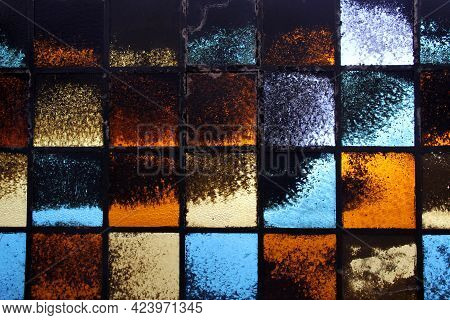 Abstract Glass Wall With Blue And Yellow Metalic Squares Ocher Black And Gray Shadows Pattern Tones