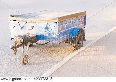 Trailer. Blue Cargo Trailer For Passenger Car. Bright Sun.