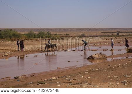 Ait-ben Haddou, Morocco. 30 September 2017. People Cross The River Asif Ounila Near The Kasbah Ait B