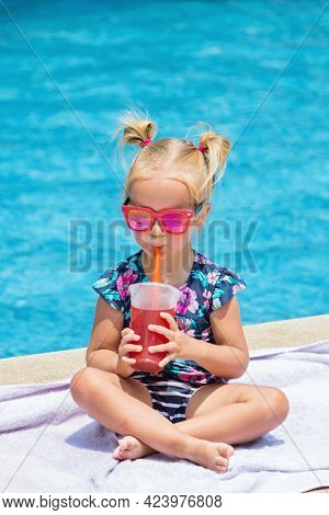 Happy Little Caucasian Toddler Girl With Sunglasses Smiling Joyfully And Enjoying Summer Vacations T