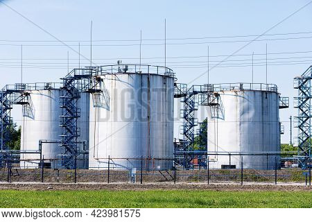 Storage Of Chemical Products Like Oil, Petrol, Diesel Fuel At Clear Summer Day.