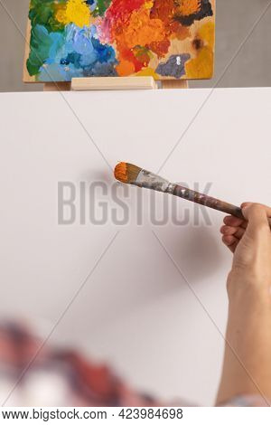 Male artist working on painting. Man artist painter in creative studio as art concept