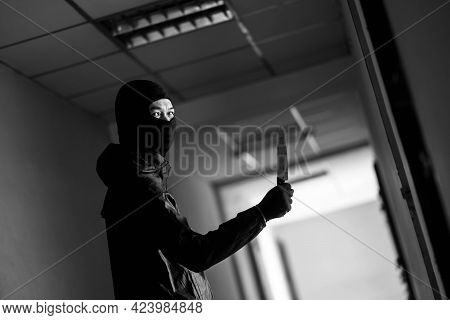 Murder, Kill And People Concept - Criminal Or Murderer With Blood On Knife At Crime Scene