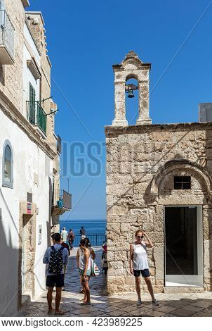 Polignano A Mare, Italy - September 17, 2019:  People Walking On The Charming And Romantic Historic