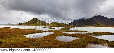 A Beautiful Shot Of Mountains In Highlands Region Of Iceland With A Cloudy Gray Sky In The Backgroun