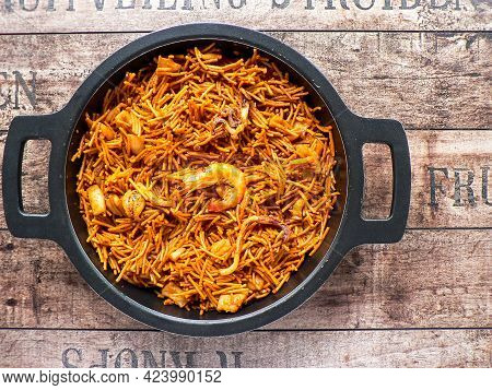 A Top View Of Noodle Paella A Typical Catalan Dish Made With Noodles And Seafood With Garlic Sauce A