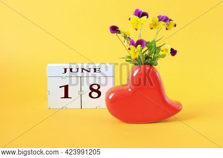 Calendar For June 18 : The Name Of The Month Of June In English, The Number 18, A Vase In The Shape
