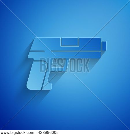 Paper Cut Pistol Or Gun Icon Isolated On Blue Background. Police Or Military Handgun. Small Firearm.