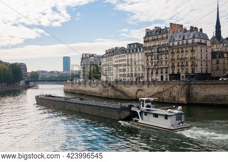 Paris, France Oct 3 2015: Barge Traveling On The Seine River In Paris, France With Beautiful Classic