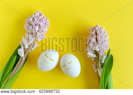 Hyacinth Flowers With Two Eggs On Bright Yellow Background With Copy Space For Text . Happy Easter.