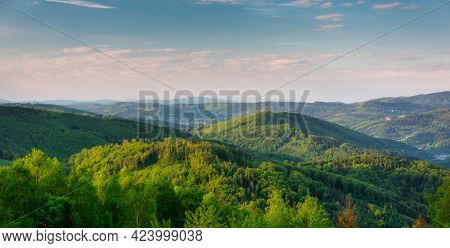 Scenery of the Silesian Beskids from Rownica peak at sunrise. Poland