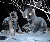 Two Ice Sculptured Rabbits frolicking in the snow scene poster