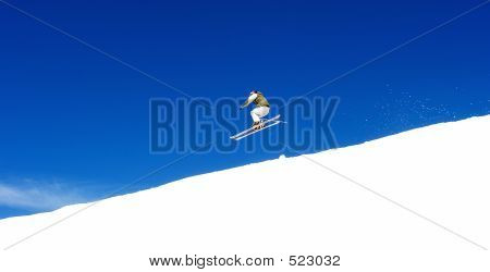 Man Skiing On Slopes Of Pradollano Ski Resort In Spain