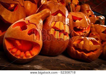 Scary Jack O Lantern halloween pumpkins in darkness