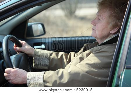 Elderly Woman-driver In Car
