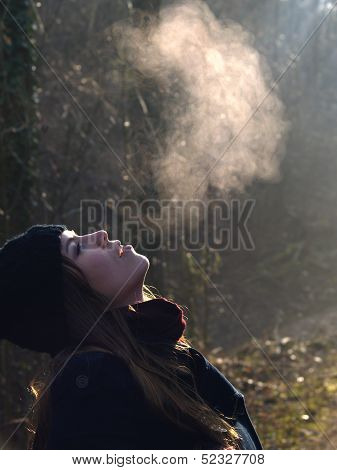 Beautiful Girl Breathing Warm Air During A Cold Autumn Morning
