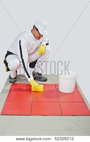 Worker clean red tiles