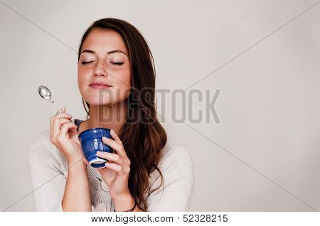 Woman Eating out of Small Dish