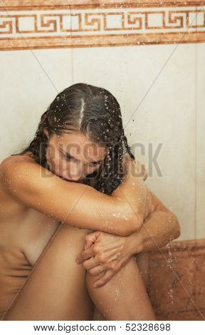 Frustrated Young Woman Sitting In Shower