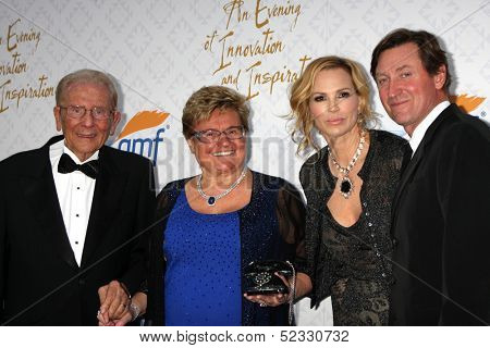 LOS ANGELES - OCT 13:  Alfred Mann, Rika Mann, Janet Jones Gretzky, Wayne Gretzky at the 10th Alfred Mann Foundation Gala at Robinson-May Lot on October 13, 2013 in Beverly Hills, CA