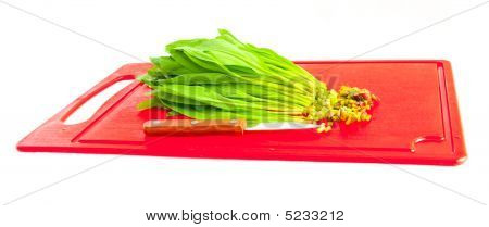The image of the cut ramson and knife poster