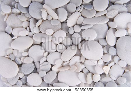 close up of the white pebbles stones background poster
