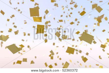 Bursting gold confetti