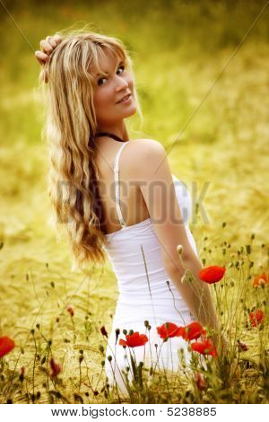 Woman On A Field With Red Poppie Flowers