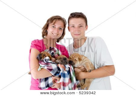 young couple with Shar Pei baby dogs almost one month old isolated poster