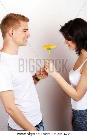 Woman Is Getting A Flower By Her Boyfriend