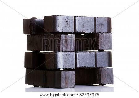 Lignite coal briquette, isolated on white