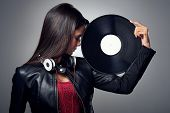 Woman dj portrait with vinyl record and headphones poster