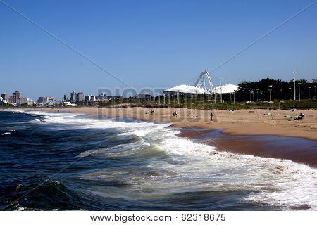Landscape View Of Beach Against City Skyline