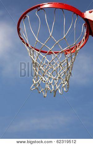 Outdoor Basketball Hoop against a cloudy sky